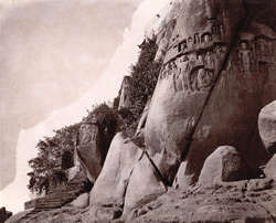 Closer view of rock-cut sculptures below the temple at Jangira, Bhagalpur District